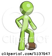 Green Design Mascot Man Standing With Foot On Football