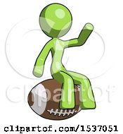 Green Design Mascot Woman Sitting On Giant Football