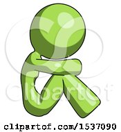 Green Design Mascot Woman Sitting With Head Down Facing Sideways Right