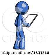 Blue Design Mascot Man Looking At Tablet Device Computer Facing Away