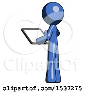 Blue Design Mascot Man Looking At Tablet Device Computer With Back To Viewer