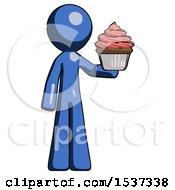 Blue Design Mascot Man Presenting Pink Cupcake To Viewer