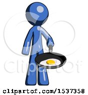 Blue Design Mascot Man Frying Egg In Pan Or Wok