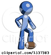 Blue Design Mascot Man Standing With Foot On Football