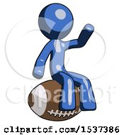 Blue Design Mascot Man Sitting On Giant Football