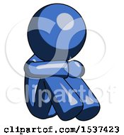 Blue Design Mascot Man Sitting With Head Down Facing Angle Right