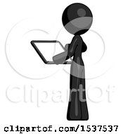 Black Design Mascot Woman Looking At Tablet Device Computer With Back To Viewer