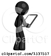 Black Design Mascot Man Looking At Tablet Device Computer Facing Away