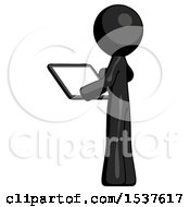 Black Design Mascot Man Looking At Tablet Device Computer With Back To Viewer