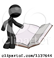 Black Design Mascot Man Reading Big Book While Standing Beside It