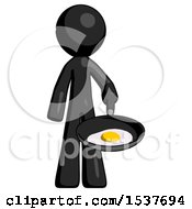 Black Design Mascot Man Frying Egg In Pan Or Wok