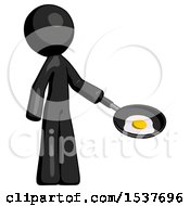 Black Design Mascot Man Frying Egg In Pan Or Wok Facing Right