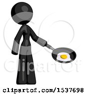 Black Design Mascot Woman Frying Egg In Pan Or Wok Facing Right