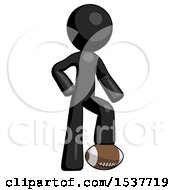 Black Design Mascot Man Standing With Foot On Football