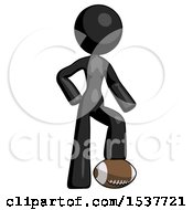 Black Design Mascot Woman Standing With Foot On Football