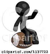 Black Design Mascot Man Sitting On Giant Football