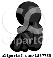 Black Design Mascot Man Sitting With Head Down Back View Facing Left