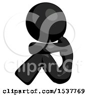 Black Design Mascot Woman Sitting With Head Down Facing Sideways Left