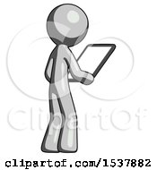Gray Design Mascot Man Looking At Tablet Device Computer Facing Away