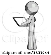 Gray Design Mascot Man Looking At Tablet Device Computer With Back To Viewer