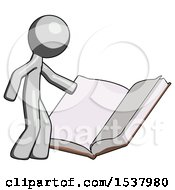 Gray Design Mascot Man Reading Big Book While Standing Beside It
