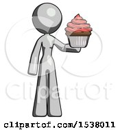 Gray Design Mascot Woman Presenting Pink Cupcake To Viewer
