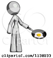 Gray Design Mascot Woman Frying Egg In Pan Or Wok Facing Right