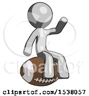 Gray Design Mascot Man Sitting On Giant Football