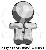 Gray Design Mascot Man Sitting With Head Down Facing Forward