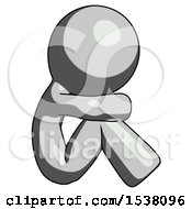 Gray Design Mascot Man Sitting With Head Down Facing Sideways Right