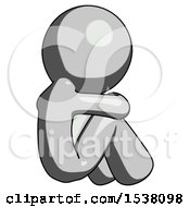 Gray Design Mascot Man Sitting With Head Down Back View Facing Right