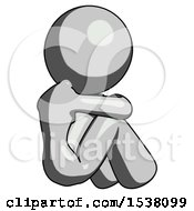 Gray Design Mascot Woman Sitting With Head Down Back View Facing Right
