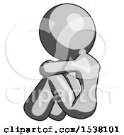 Gray Design Mascot Woman Sitting With Head Down Back View Facing Left