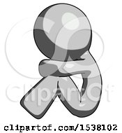 Gray Design Mascot Man Sitting With Head Down Facing Sideways Left