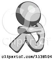 Gray Design Mascot Woman Sitting With Head Down Facing Sideways Left