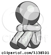 Gray Design Mascot Man Sitting With Head Down Facing Angle Left