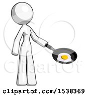 White Design Mascot Woman Frying Egg In Pan Or Wok Facing Right