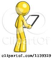 Yellow Design Mascot Man Looking At Tablet Device Computer Facing Away
