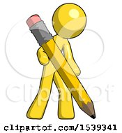Yellow Design Mascot Man Writing With Large Pencil