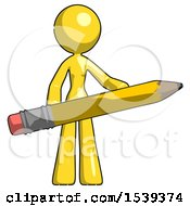 Yellow Design Mascot Woman Office Worker Or Writer Holding A Giant Pencil