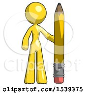 Yellow Design Mascot Woman With Large Pencil Standing Ready To Write