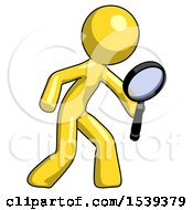 Yellow Design Mascot Man Inspecting With Large Magnifying Glass Right