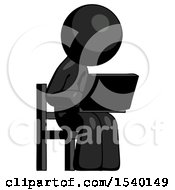 Black Design Mascot Man Using Laptop Computer While Sitting In Chair Angled Right