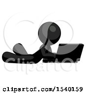 Black Design Mascot Man Using Laptop Computer While Lying On Floor Side Angled View