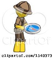 Yellow Explorer Ranger Man Looking At Large Compass Facing Right