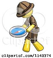 Yellow Explorer Ranger Man Walking With Large Compass