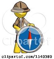 Yellow Explorer Ranger Man Standing Beside Large Compass