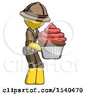 Yellow Explorer Ranger Man Holding Large Cupcake Ready To Eat Or Serve