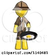 Yellow Explorer Ranger Man Frying Egg In Pan Or Wok