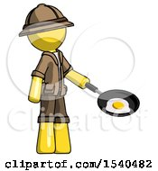 Yellow Explorer Ranger Man Frying Egg In Pan Or Wok Facing Right